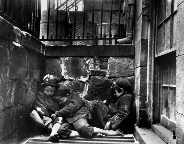 Orphan children sleeping in New York street circa 1890.