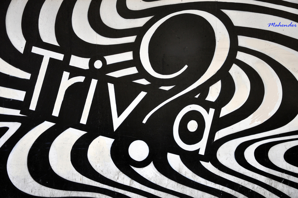 "The word ""Triv?a"" in black and white in a wall mural."