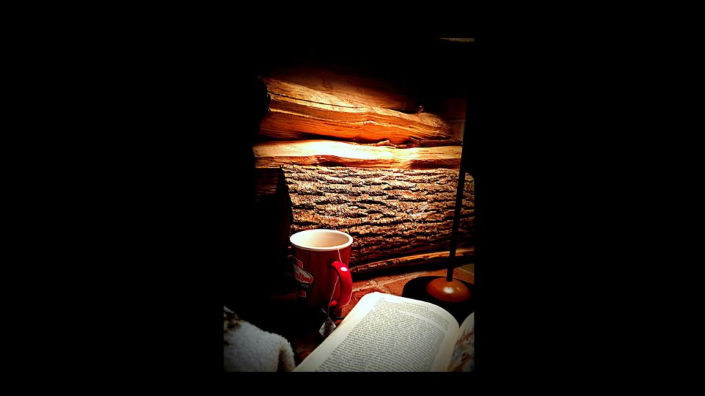 image of fireplace, coffee cup and book by daBinsi