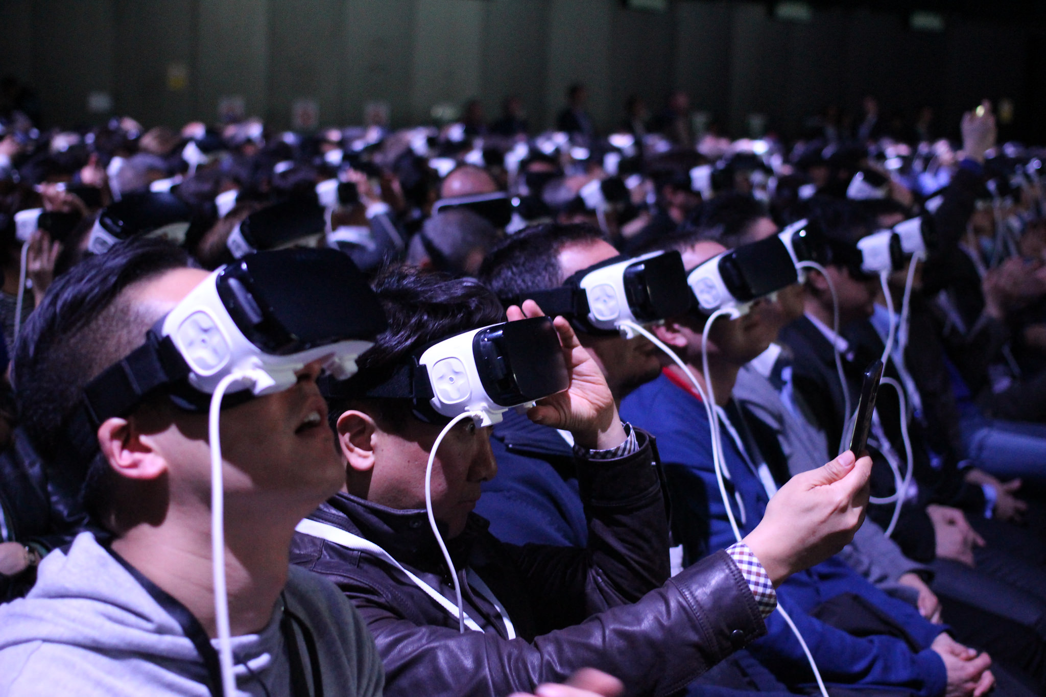 Group of people trying virtual reality.