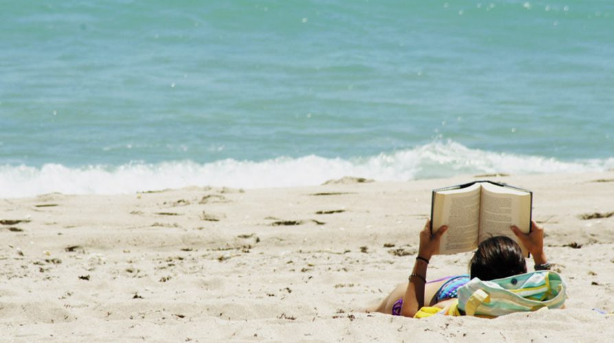 Woman reading on a beach.