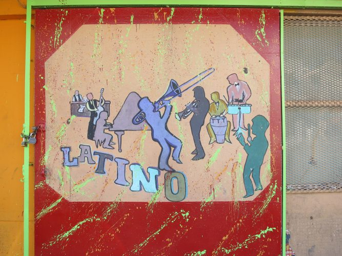 "Painted mural of musicians with ""Latino"" by Paul Sableman, used under CC Attribution License"