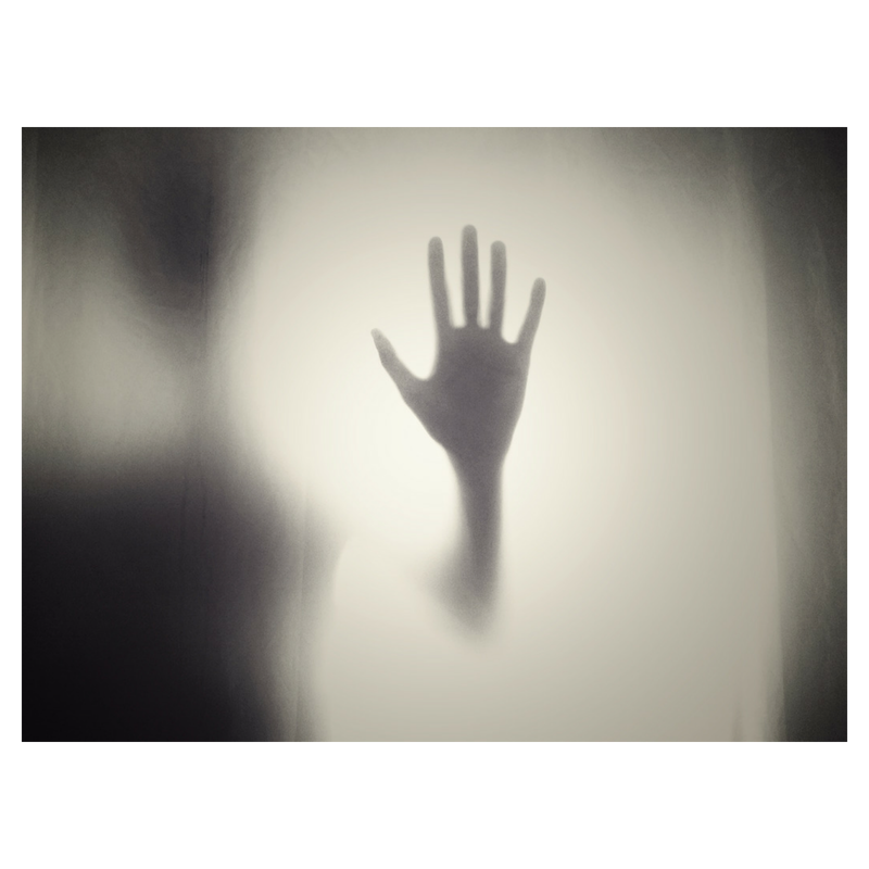 hand against frosted glass