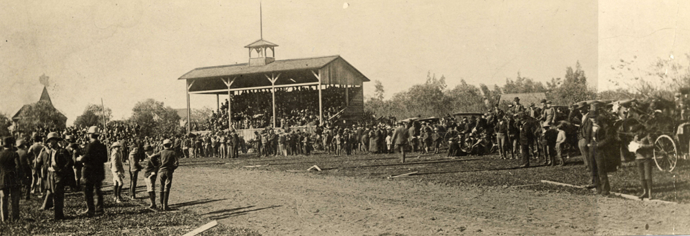 Image of racing grounds with pavilion and crowds lining both sides of track, 1890. Source: http://pasadenadigitalhistory.com