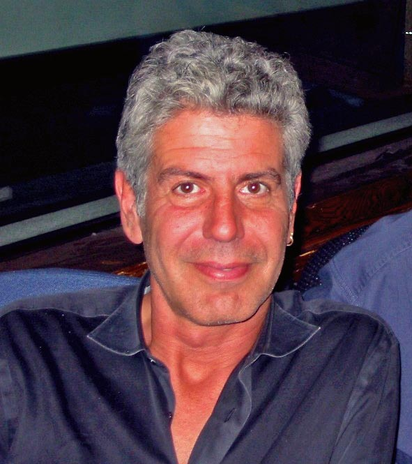 Color image of Anthony Bourdain (head and shoulders), smiling at camera