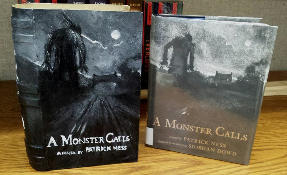 "Teen volunteer Mariah D. hand painted this incredible ""A Monster Calls"" book box, which was raffled out at our A Monster Calls discussion on June 26 at Central."