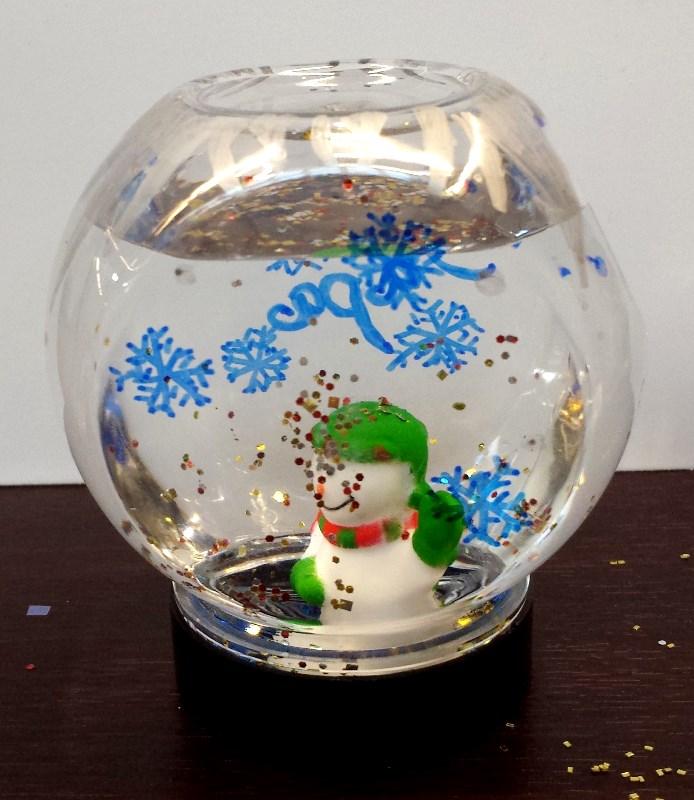 Snowman snowglobe by Amy S. age 15