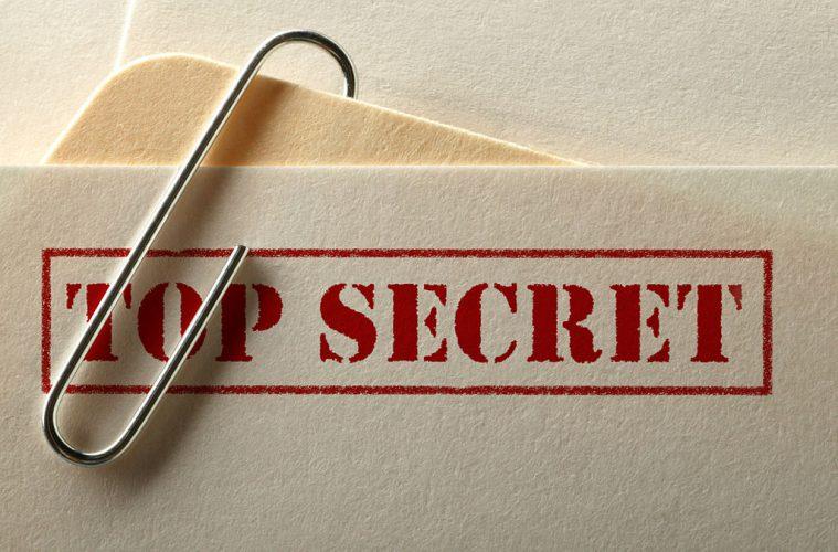"Folders labeled ""Top Secret"""
