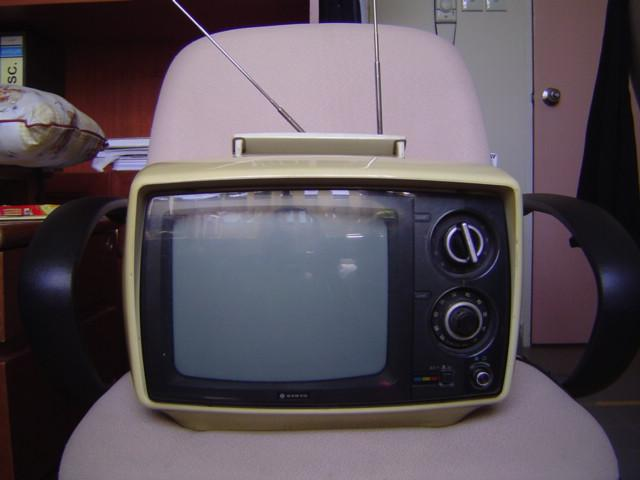 image of early portable television on chair
